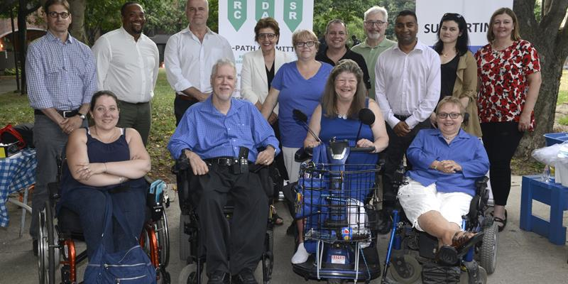 The Accessibility team, made up of TCHC staff and R-PATH committee members, posing outside at the R-PATH third anniversary BBQ